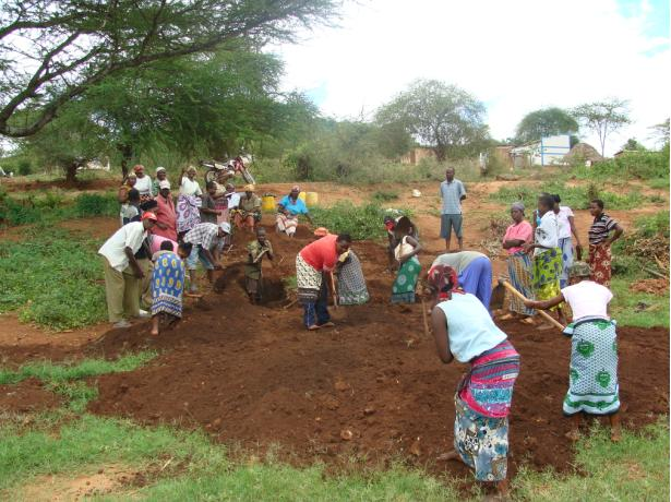 Mwatate Singila Community preparing land for the well project